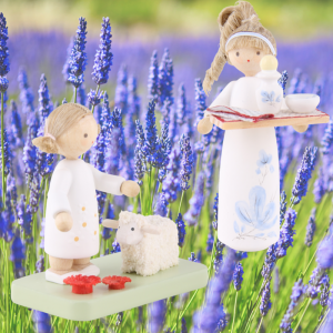 Figure of the year 'Blue flower' and flax haired child with lamb